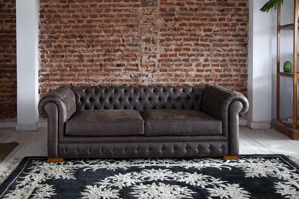 кожаный диван с каретной стяжкой